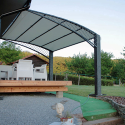 A wrought iron awning in a family house patio