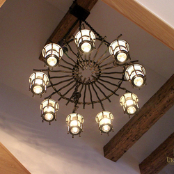 Luxury chandelier designed and hand-forged in UKOVMI for a family house - design lighting