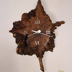 Thousand year-old Oak Tree Clock - a luxury oak tree trunk clock complemented by modern stainless steel elements