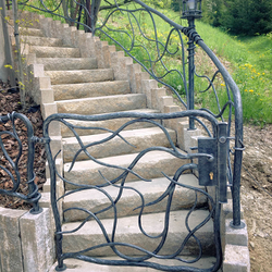 A hand wrought iron gate - a exclusive gate