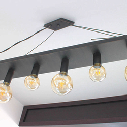 Modern pendant lighting with a rhomboid shape - forged interior chandelier
