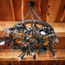 A hand wrought iron light - a wrought iron chandelier Pine