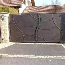 A wrought iron gate - privacy as art - An exclusive gate