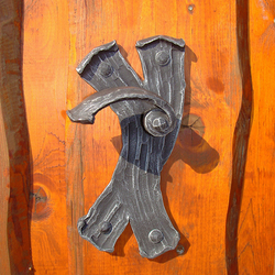 A wrought iron handle - bark