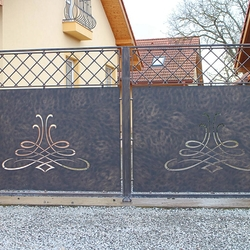 A wrought iron fence - A full gate
