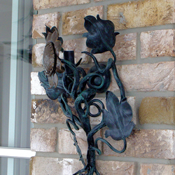 A wrought iron sunflower as a side lamp
