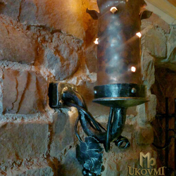 A side wrought iron lamp and copper wrough tshade