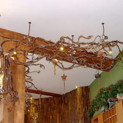 A wrought iron chandelier- roots - Hotel Galileo reception- Donovaly - a luxurious chandelier