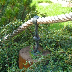 A wrought iron rope holder