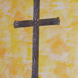 A wrought iron wall cross
