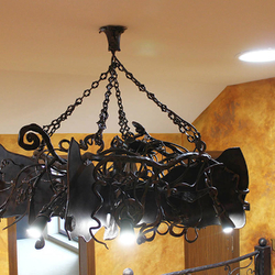 A wrought iron bat above a gallery