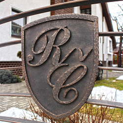 A wrought iron coat of arms - initials