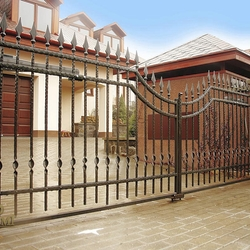 A wrought iron gate - A hand forged gate in a simple style