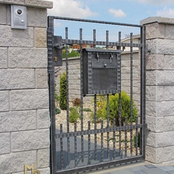 A wrought iron gate without railheads