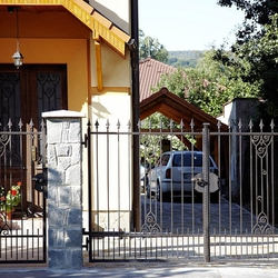 A wrought iron gate - a historic pattern replica - An exclusive gate