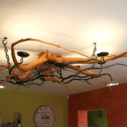 A wrought iron chandelier - A  hanging light