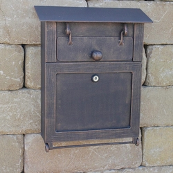 A wrought iron post box